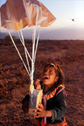 A child catches a parachute with a radio attached